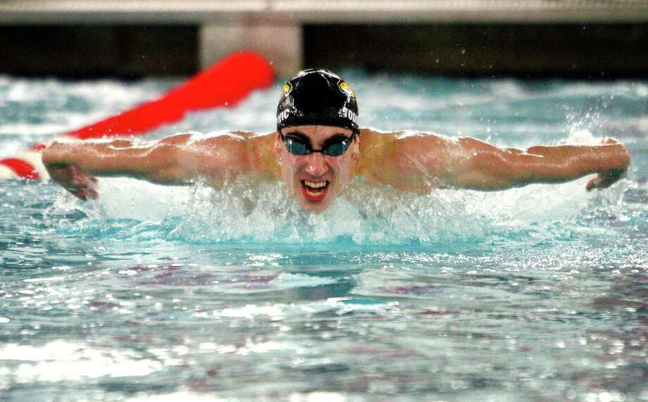 Greenwich's Stephan Todorovic competes in the 100-meter butterfly during a meet with New Canaan on Jan. 11. Photo: Christian Abraham / Hearst Connecticut Media / Connecticut Post