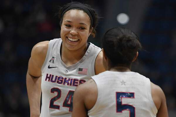 UConn's Napheesa Collier (24) has played in 100 straight games, just the fifth Husky to reach the milestone. and Connecticut's Crystal Dangerfield (5) during the first half of an NCAA college basketball game, Wednesday, Feb. 20, 2019, in Hartford, Conn. (AP Photo/Jessica Hill)