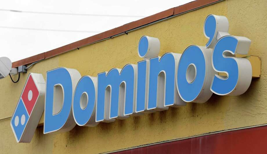 FILE - This Thursday, Oct. 27, 2016, photo shows a Domino's Pizza sign at a location in Hialeah, Fla.   Domino's Pizza Inc. on Thursday, Feb. 21, 2019  reported fourth-quarter earnings of $111.6 million. On a per-share basis, the Ann Arbor, Michigan-based company said it had net income of $2.62.(AP Photo/Alan Diaz, File) Photo: Alan Diaz / Copyright 2016 The Associated Press. All rights reserved.