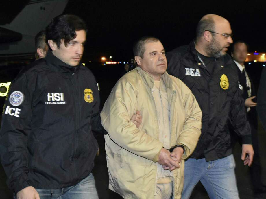 "Authorities escort Joaquin ""El Chapo"" Guzman from a plane to a waiting caravan of SUVs at Long Island MacArthur Airport in Ronkonkoma, N.Y. The notorious Mexican drug lord was convicted of drug-trafficking charges, Feb. 12, in federal court in New York. A reader questions the effectiveness of a border wall. Photo: /Associated Press / United States Drug Enforcement A"