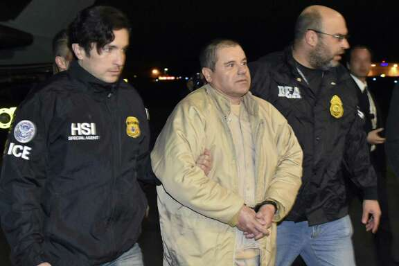 """Authorities escort Joaquin """"El Chapo"""" Guzman from a plane to a waiting caravan of SUVs at Long Island MacArthur Airport in Ronkonkoma, N.Y. The notorious Mexican drug lord was convicted of drug-trafficking charges, Feb. 12, in federal court in New York. A reader questions the effectiveness of a border wall."""