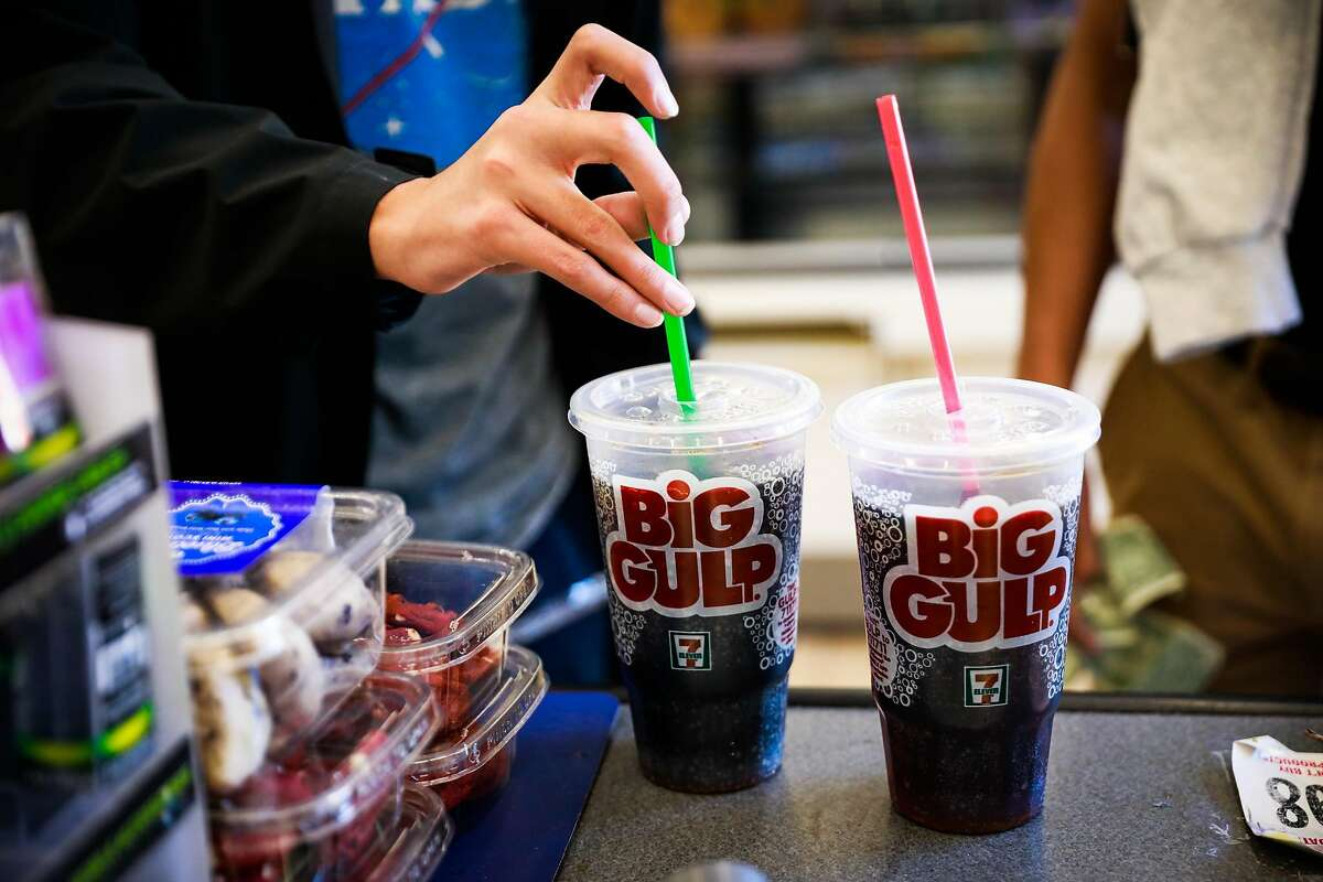 Carlos Ramirez, 16, puts a straw in his Big Gulp soda while purchasing it at 7-11 on Mission Street in San Francisco, California, on Monday, Feb. 18, 2019.