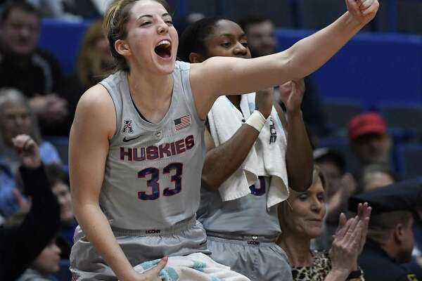 UConn's Katie Lou Samuelson cheers on the Huskies from the bench against Memphis on Wednesday night at the XL Center in Hartford. Samuelson finished with a season-high 32 points, 10 rebounds and seven assists in a 102-45 win.
