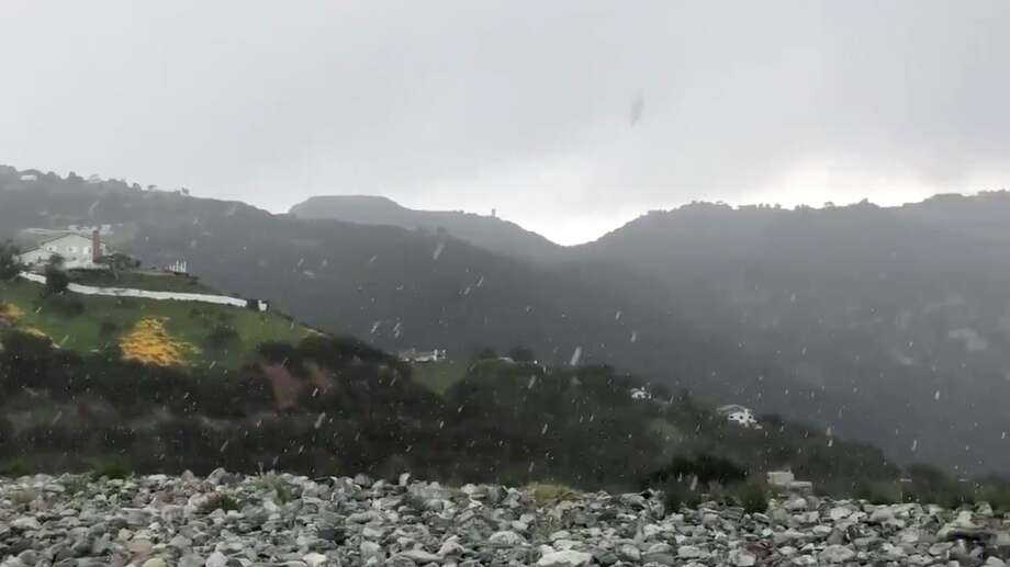 Rare snow falls in Malibu, only miles from the beach