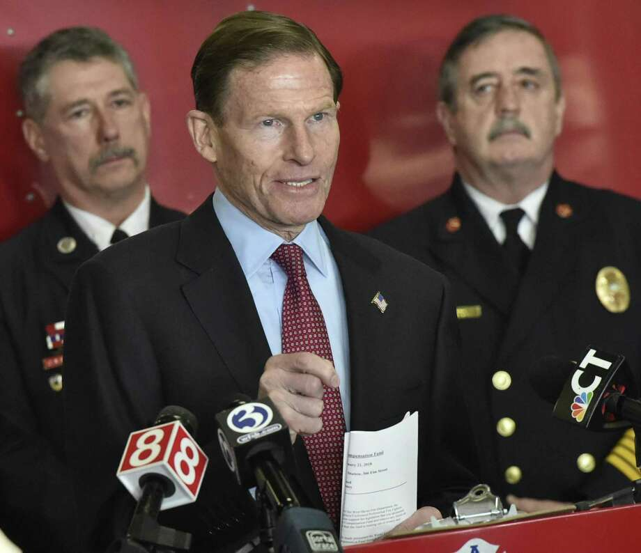 With West Haven Fire Department Lt. William Heffernan, left, and Fire Chief James P. O'Brien, right, U.S. Sen.  Richard Blumenthal, D-Conn.,  calls for fully funding the September 11th Victims Compensation Fund. Photo: Peter Hvizdak / Hearst Connecticut Media / New Haven Register