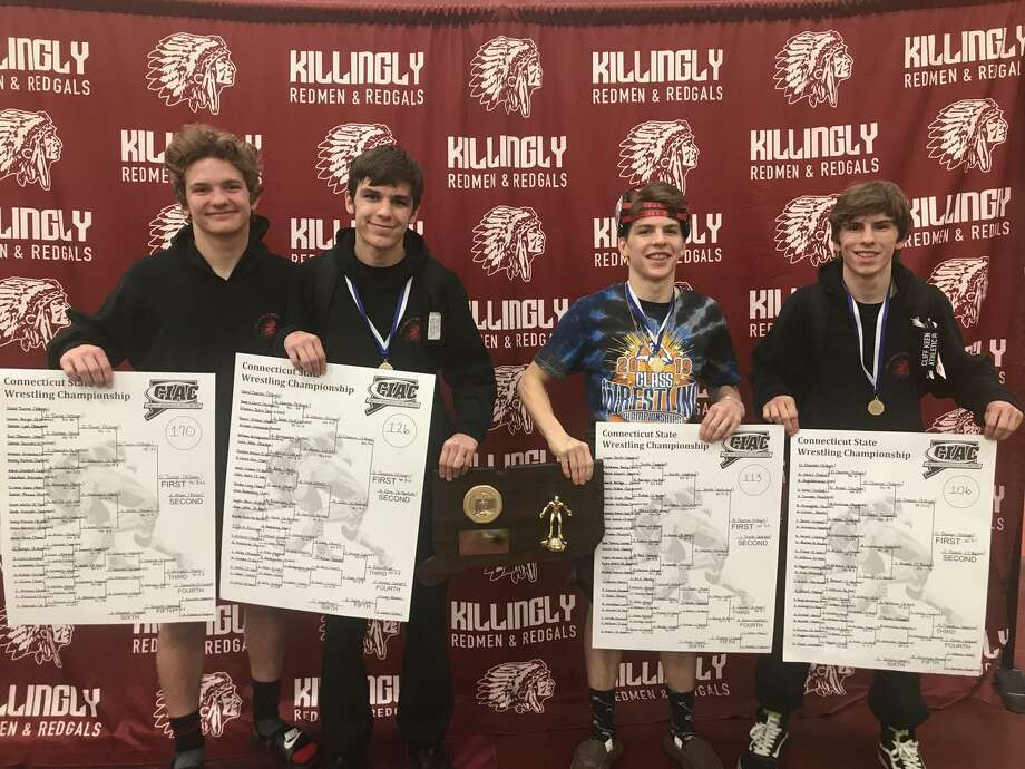 Class M wrestling champions David Charron (126 pounds), Mike Charron (113) and Danny Charron (106) with Killingly High teammate Derek Turner (left, 170). Photo: Submitted