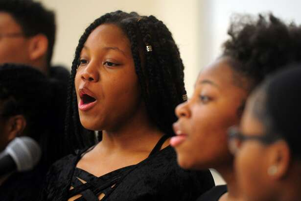 Janae Hunter, a sophomore in Harding High School's choir, sings during the Third Annual Black History Celebration held at the main branch of the Bridgeport Public Library, in Bridgeport, Conn. Feb. 21, 2019.