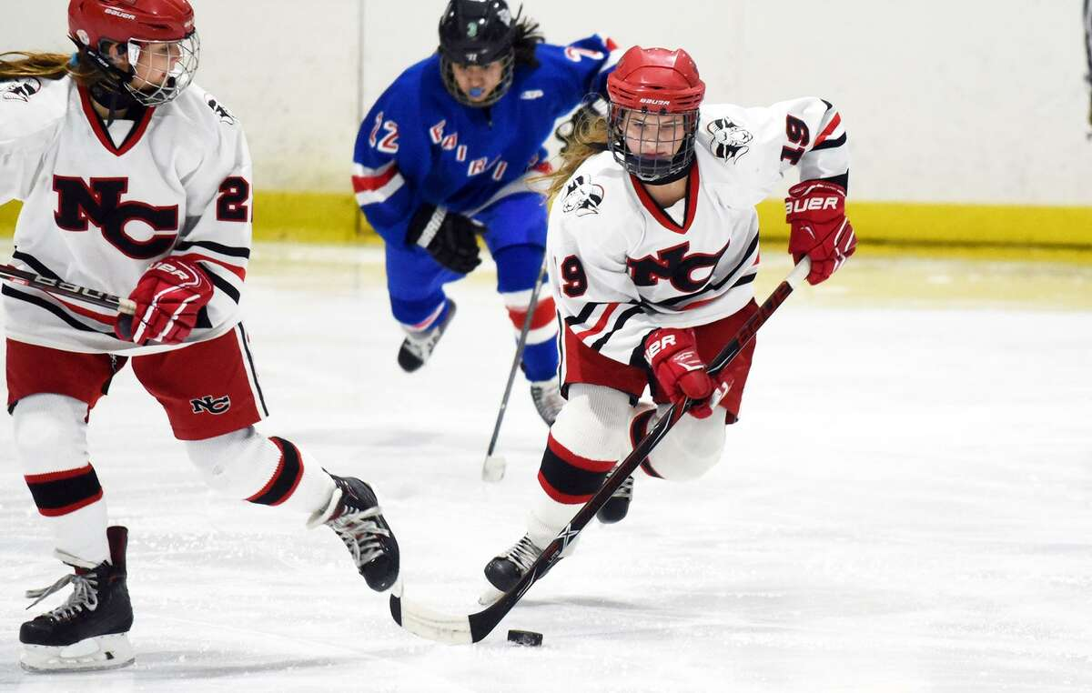 New Canaan sophomore McKenna Harden (19) skates into the zone during the FCIAC girls ice hockey semifinals at the Darien Ice House on Thursday, Feb. 21. - Dave Stewart/Hearst Connecticut Media photo