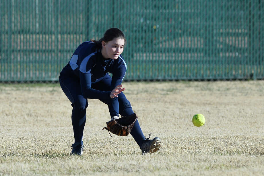 Greenwood's Kaitlan Keel (7) stops a ball hit by Andrews during the West Texas Classic softball tournament Feb. 21, 2019, at Ulmer Park. James Durbin/Reporter-Telegram Photo: James Durbin / ? 2019 Midland Reporter-Telegram. All Rights Reserved.