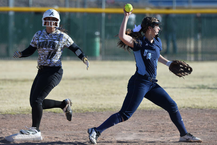 Greenwood's Karlie Savage throws to first for a double play after stepping off second base during a West Texas Classic softball tournament game against Andrews Feb. 21, 2019, at Ulmer Park. James Durbin/Reporter-Telegram Photo: James Durbin / ? 2019 Midland Reporter-Telegram. All Rights Reserved.