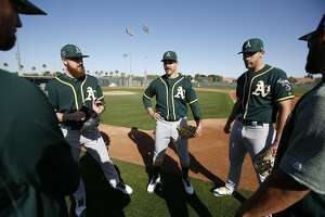 MESA, AZ - FEBRUARY 20: Paul Blackburn #58 and Daniel Mengden #33 of the Oakland Athletics talk with teammates on the field during a spring training workout at Fitch Park on February 20, 2018 in Mesa, Arizona. (Photo by Michael Zagaris/Oakland Athletics/Getty Images)  *** Local Caption *** Paul Blackburn;Daniel Mengden