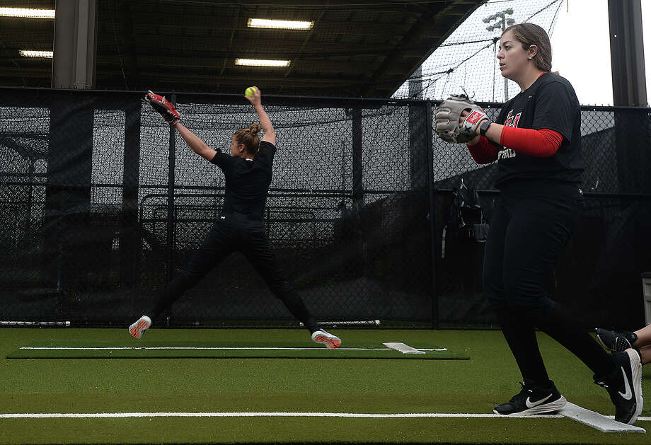 Lamar's softball team, including pitchers Erin Kyle and Julia Voluntad, gets in practice Thursday before Friday's Cardinal Classic and home opener against Rhode Island. Photo taken Thursday, February 21, 2019 Kim Brent/The Enterprise Photo: Kim Brent, The Enterprise / BEN