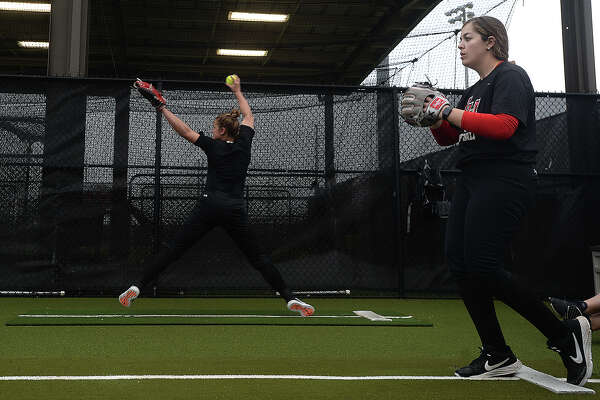 Lamar's softball team, including pitchers Erin Kyle and Julia Voluntad, gets in practice Thursday before Friday's Cardinal Classic and home opener against Rhode Island. Photo taken Thursday, February 21, 2019 Kim Brent/The Enterprise