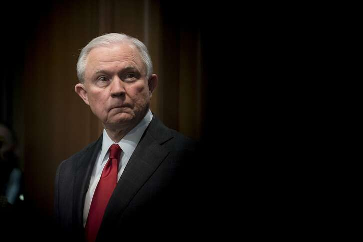 FILE — Attorney General Jeff Sessions attends a news conference at the Department of Justice in Washington, Oct. 26, 2018. Trump's public war on the investigations encircling him has gone on long enough that it is no longer shocking. Now, an examination by The New York Times reveals the extent of an even more sustained, more secretive assault on the machinery of federal law enforcement. (Erin Schaff/The New York Times)