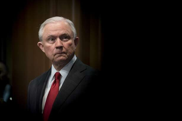 FILE - Attorney General Jeff Sessions attends a news conference at the Department of Justice in Washington, Oct. 26, 2018. Trump's public war on the investigations encircling him has gone on long enough that it is no longer shocking. Now, an examination by The New York Times reveals the extent of an even more sustained, more secretive assault on the machinery of federal law enforcement. (Erin Schaff/The New York Times)