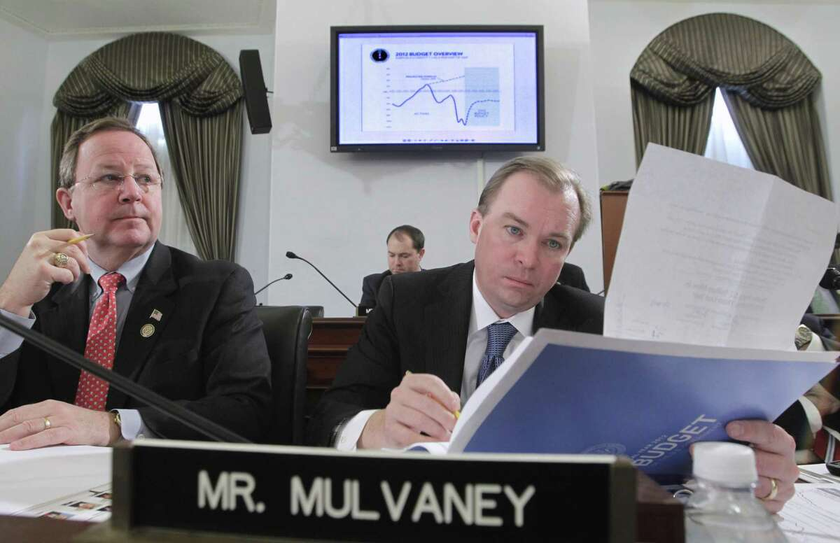 Rep. Bill Flores, R-Waco, at a hearing with then- Rep. Mick Mulvaney, R-S.C., now acting chief of staff to President Donald Trump. Nowadays, Flores can be found telling other members of the House Energy committee about the solar system he installed on his roof and advocating for a market-driven approaches to climate change such asinvesting in batteries and other clean energy technology rather than regulating emissions