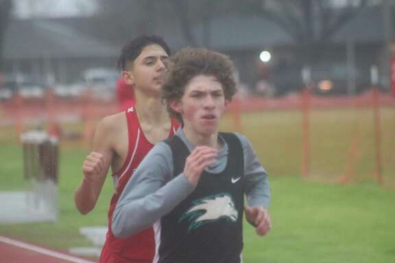 Pasadena Memorial High School Gavin Erskins holds off Clear Lake's Sebastian Langer at the finish line for first place in the 1600-meter freshmen run at Deer Park's Bubba McLean Stadium Thursday afternoon.