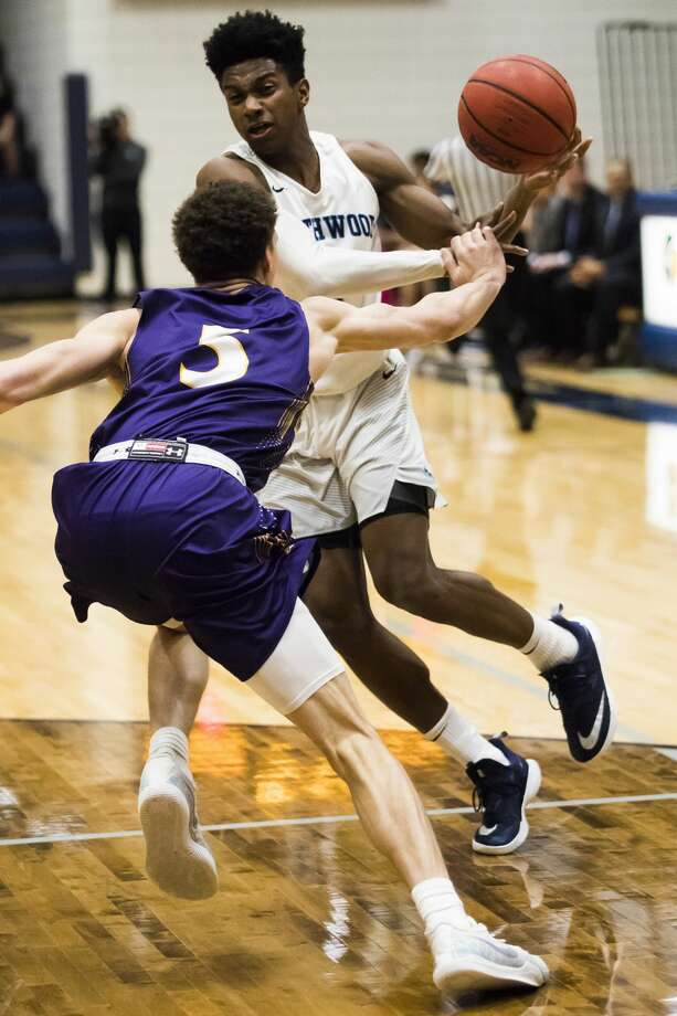 Northwood's Trey McBride dribbles down the court during a game against Ashland on Thursday, Feb. 21, 2019 at Northwood University. (Katy Kildee/kkildee@mdn.net) Photo: (Katy Kildee/kkildee@mdn.net)