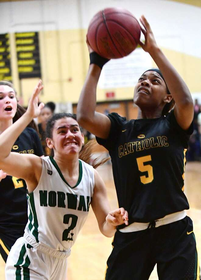 Trinity Catholic's Kyah Nowlin goes up for the shot against Norwalk's Ashley Wilson during the FCIAC championship game on Thursday. Photo: Erik Trautmann / Hearst Connecticut Media / Norwalk Hour