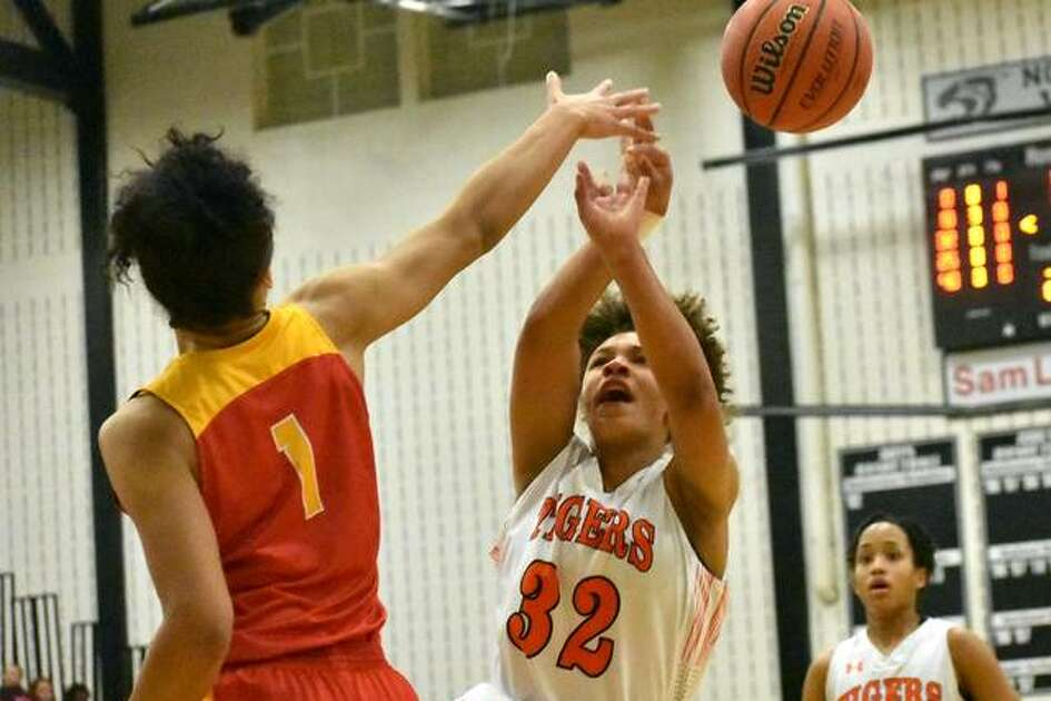 Edwardsville forward Maria Smith, right, has her shot blocked by Rock Island's Brea Beal in the first quarter.