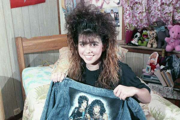 A 14-year-old was suspended from a Galveston County school for wearing a rock 'n' roll T-shirt against a new policy set by the school's principal. Here, the teen shows off some of her clothes, Feb. 16, 1989.