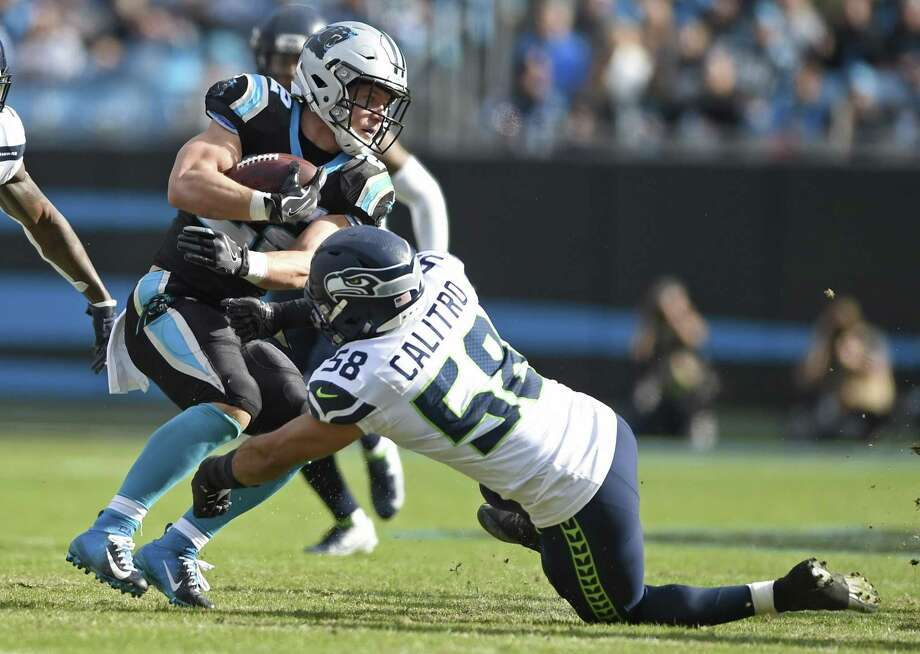 Carolina Panthers' Christian McCaffrey (22) is stopped by Seattle Seahawks' Austin Calitro (58) during the first half of an NFL football game in Charlotte, N.C., Sunday, Nov. 25, 2018. (AP Photo/Mike McCarn) Photo: Mike McCarn / AP / Copyright 2018 The Associated Press. All rights reserved