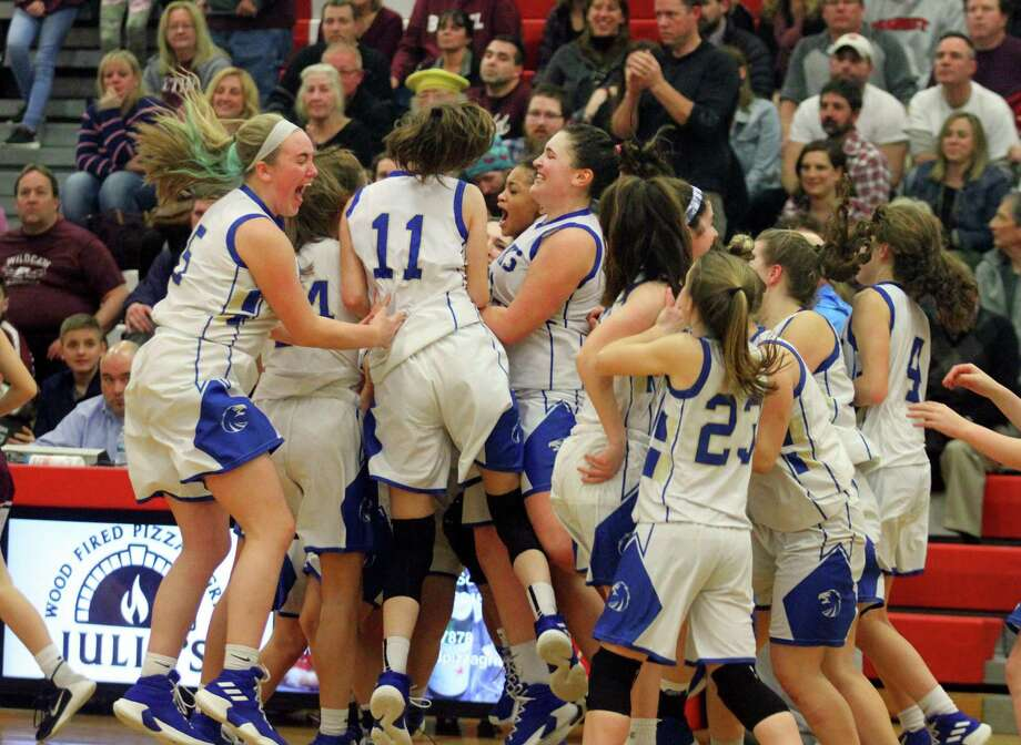 Newtown celebrates its win over Bethel in the SWC championship game Thursday in Southbury. Photo: Christian Abraham / Hearst Connecticut Media / Connecticut Post