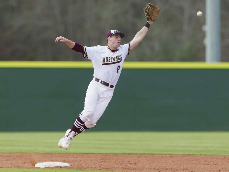 In this file photo, Magnolia West shortstop Zach Wall (8) leaps for a single in the fourth inning of a high school baseball game during the Don Newcomb Classic, Friday, March 2, 2018, in Porter. Photo: Jason Fochtman, Staff Photographer / Houston Chronicle / © 2018 Houston Chronicle