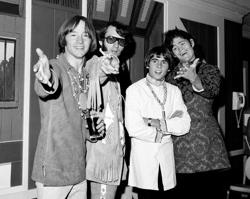 FILE - This July 6, 1967 file photo shows, from left, Peter Tork, Mike Nesmith, David Jones and Micky Dolenz of the musical group The Monkees at a news conference at the Warwick Hotel in New York. Tork, who rocketed to teen idol fame in 1965 playing the lovably clueless bass guitarist in the made-for-television rock band The Monkees, died Thursday, Feb. 21, 2019, of complications related to cancer, according to his son Ivan Iannoli. He was 77. (AP Photo/Ray Howard, File)