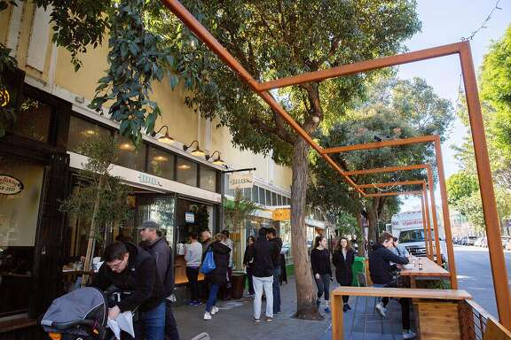 People at the parklet outside Souvla restaurant on Hayes Street, Monday, Feb. 18, 2019, in San Francisco, Calif.