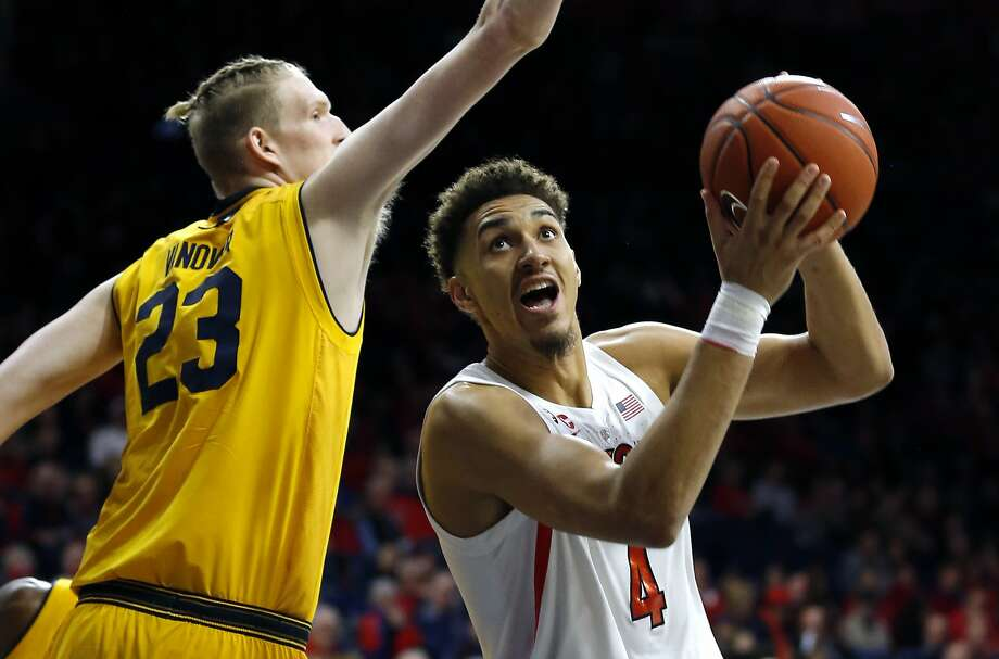 Arizona center Chase Jeter (4) drives on California center Connor Vanover during the second half of an NCAA college basketball game Thursday, Feb. 21, 2019, in Tucson, Ariz. Arizona won 76-51. (AP Photo/Rick Scuteri) Photo: Rick Scuteri / Associated Press