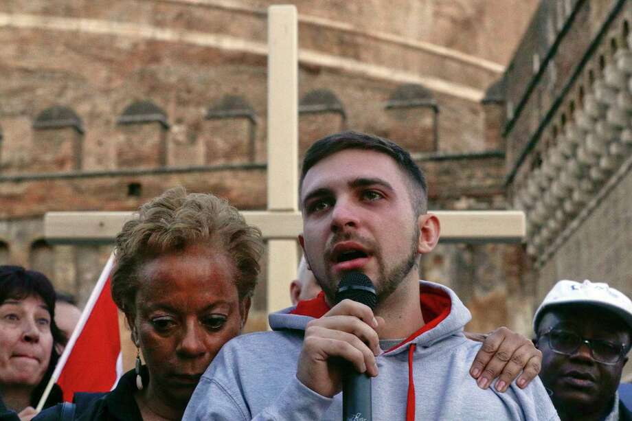 Sex abuse survivor Alessandro Battaglia, right, is hugged by survivor and founding member of the ECA (Ending Clergy Abuse), Denise Buchanan, as he speaks during a twilight vigil prayer near Castle Sant' Angelo, in Rome, Thursday, Feb. 21, 2019. Pope Francis opened a landmark sex abuse prevention summit Thursday by warning senior Catholic figures that the faithful are demanding concrete action against predator priests and not just words of condemnation. (AP Photo/Gregorio Borgia) Photo: Gregorio Borgia / Copyright 2019 The Associated Press. All rights reserved