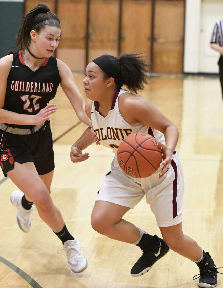 Colonie's Aliyah Wright dribbles the ball past Guilderland's Graycen Dubin during their sectional quarterfinal on Thursday, Feb. 21, 2019, in Clifton Park, N.Y. (Jenn March, Special to the Times Union )