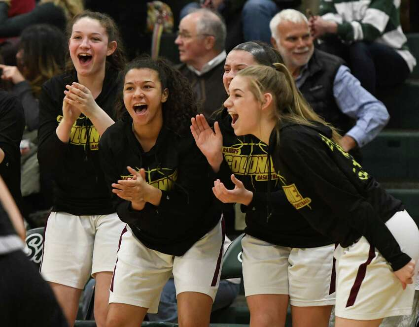 Colonie varsity basketball players cheer for their teammates as they surpass the score of their opponents, the Guilderland team, during their sectional quarterfinal on Thursday, Feb. 21, 2019, in Clifton Park, N.Y. (Jenn March, Special to the Times Union )