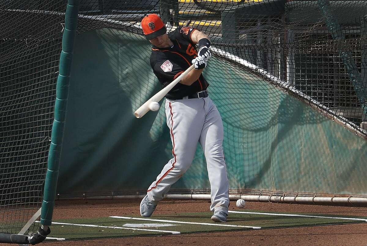 San Francisco Giants catcher Buster Posey hits during a spring training baseball practice, Friday, Feb. 15, 2019, in Scottsdale, Ariz. (AP Photo/Matt York)