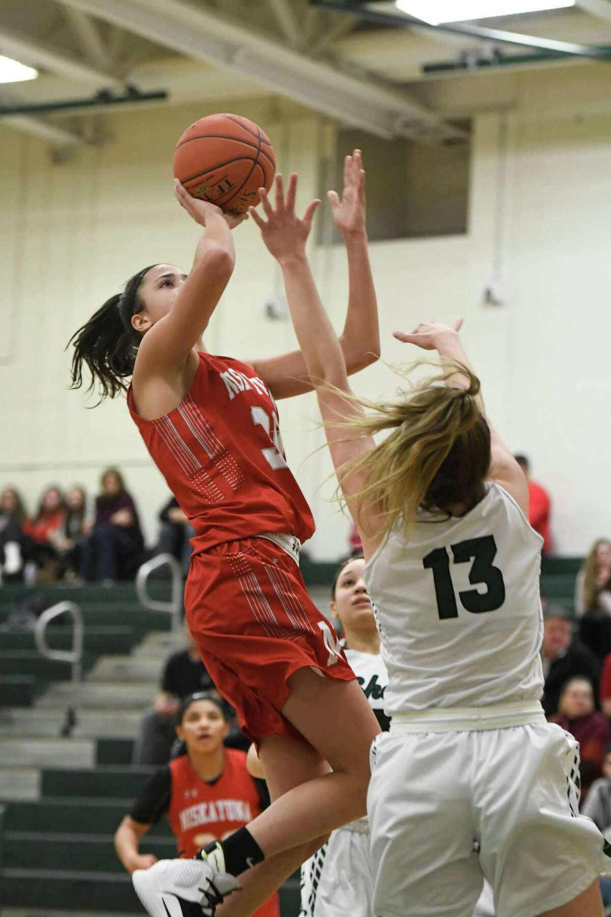 Shen's Jess Wagoner attempts to block a shot by Niskayuna's Olivia Olsen during their sectional quarterfinal on Thursday, Feb. 21, 2019, in Clifton Park, N.Y. (Jenn March, Special to the Times Union)
