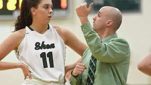 Shen head coach Joseph Murphy speaks to forward Cat Almeida during a timeout in their sectional quarterfinal against Niskayuna on Thursday, Feb. 21, 2019, in Clifton Park, N.Y. (Jenn March, Special to the Times Union )