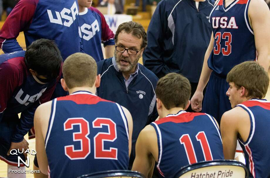 USA boys varsity basketball head coach talks with his players during a timeout, at last year's district tournament, in Bad Axe. Gainforth has become one of the most successful coaches the Thumb has seen. Wednesday night, he recorded his 400th career win, to go with a state runner-up, four regionals, 12 conference titles and 13 districts. Photo: Quad N Production/For The Tribune / ©Quad N Productions