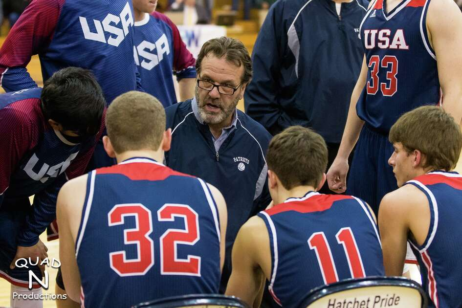 USA boys varsity basketball head coach talks with his players during a timeout, at last year's district tournament, in Bad Axe. Gainforth has become one of the most successful coaches the Thumb has seen. Wednesday night, he recorded his 400th career win, to go with a state runner-up, four regionals, 12 conference titles and 13 districts.