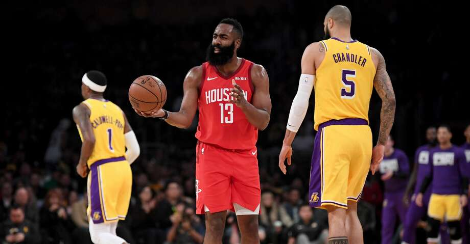 LOS ANGELES, CALIFORNIA - FEBRUARY 21:  James Harden #13 of the Houston Rockets reacts to his third foul between Kentavious Caldwell-Pope #1 and Tyson Chandler #5 of the Los Angeles Lakers during the first quarter at Staples Center on February 21, 2019 in Los Angeles, California. (Photo by Harry How/Getty Images) Photo: Harry How/Getty Images