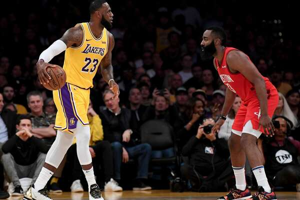 LOS ANGELES, CALIFORNIA - FEBRUARY 21: LeBron James #23 of the Los Angeles Lakers dribbles toward James Harden #13 of the Houston Rockets during the first half at Staples Center on February 21, 2019 in Los Angeles, California. (Photo by Harry How/Getty Images)