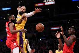 LOS ANGELES, CALIFORNIA - FEBRUARY 21: James Harden #13 of the Houston Rockets makes a pass to Clint Capela #15 in front of Tyson Chandler #5 of the Los Angeles Lakers during the first half at Staples Center on February 21, 2019 in Los Angeles, California. (Photo by Harry How/Getty Images)