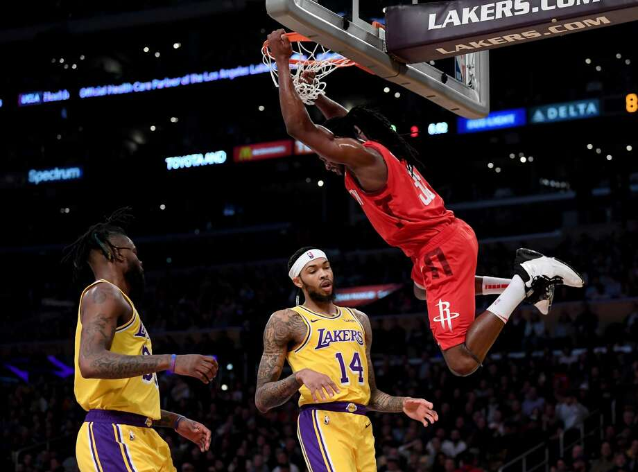 LOS ANGELES, CALIFORNIA - FEBRUARY 21:  Brandon Ingram #14 an Reggie Bullock #35 of the Los Angeles Lakers react to a dunk from Kenneth Faried #35 of the Houston Rockets during the first half at Staples Center on February 21, 2019 in Los Angeles, California. (Photo by Harry How/Getty Images) Photo: Harry How/Getty Images