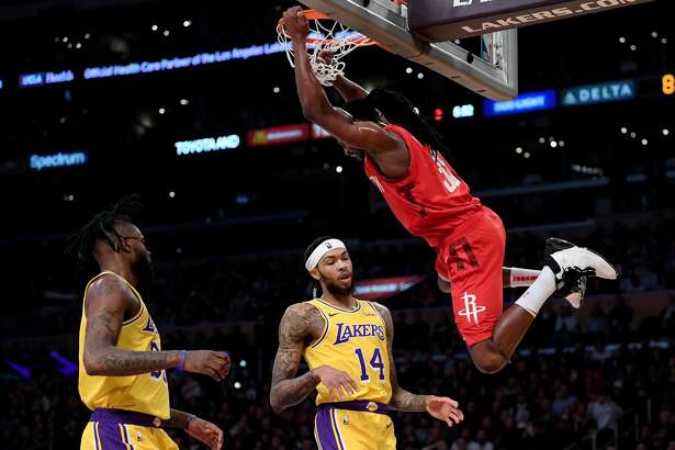 LOS ANGELES, CALIFORNIA - FEBRUARY 21: Brandon Ingram #14 an Reggie Bullock #35 of the Los Angeles Lakers react to a dunk from Kenneth Faried #35 of the Houston Rockets during the first half at Staples Center on February 21, 2019 in Los Angeles, California. (Photo by Harry How/Getty Images)