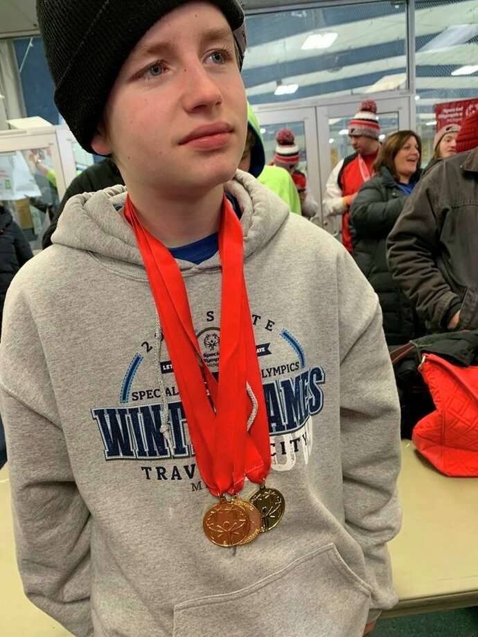 Hayden Coyer wears his three speed skating gold medals from the recent Special Olympics Michigan State Winter Games in Traverse City. (Photo provided)
