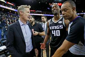 Golden State Warriors' head coach Steve Kerr jokes with Sacramento Kings' Harrison Barnes after Warriors' 125-123 win in NBA game at Oracle Arena in Oakland, Calif., on Thursday, February 21, 2019.