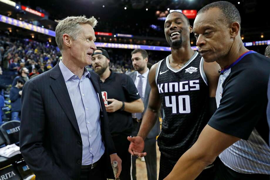 In this file photo, Golden State Warriors' head coach Steve Kerr jokes with Sacramento Kings' Harrison Barnes after the Warriors' 125-123 win at Oracle Arena in Oakland, Calif., on Thursday, February 21, 2019. Photo: Scott Strazzante / The Chronicle