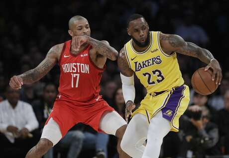 Los Angeles Lakers' LeBron James (23) is defended by Houston Rockets' PJ Tucker (17) during the second half of an NBA basketball game Thursday, Feb. 21, 2019, in Los Angeles. (AP Photo/Marcio Jose Sanchez)