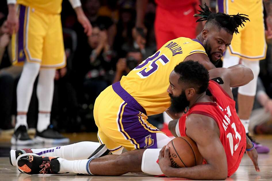 LOS ANGELES, CALIFORNIA - FEBRUARY 21: Reggie Bullock #35 of the Los Angeles Lakers dives for the ball with James Harden #13 of the Houston Rockets during a 111-106 Laker win at Staples Center on February 21, 2019 in Los Angeles, California. (Photo by Harry How/Getty Images)