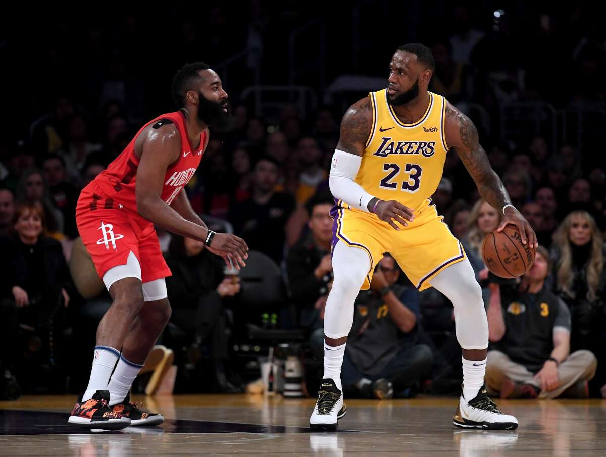 LOS ANGELES, CALIFORNIA - FEBRUARY 21: LeBron James #23 of the Los Angeles Lakers backs in on James Harden #13 of the Houston Rockets during a 111-106 Laker win at Staples Center on February 21, 2019 in Los Angeles, California. (Photo by Harry How/Getty Images)